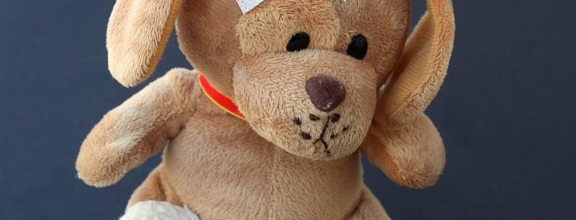 stuffed animal with bandage on head