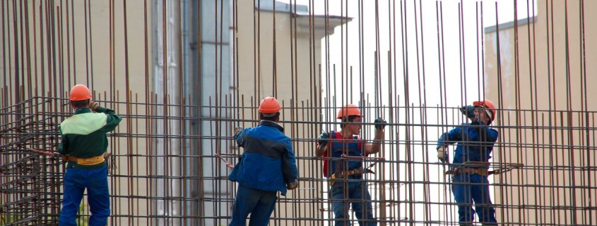 workers building a wall